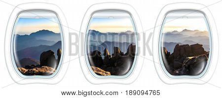 Three porthole frame windows of the holy summit of Mount Sinai, Aka Jebel Musa, 2285 meters, at sunrise, Sinai Peninsula in Egypt.