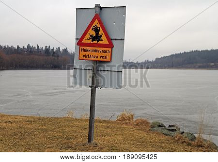 Hameenlinna Finland - April 6 2017: warning sign for walkers about quigmare nearly Hameenlinna castle Finland