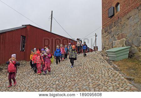 Hameenlinna Finland - April 6 2017: students are leaving Hameen castle after visiting Finland