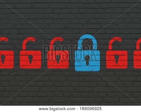 Safety concept: row of Painted red opened padlock icons around blue closed padlock icon on Black Brick wall background