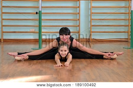 Mother and little girl rhythmic gymnastic portrait.