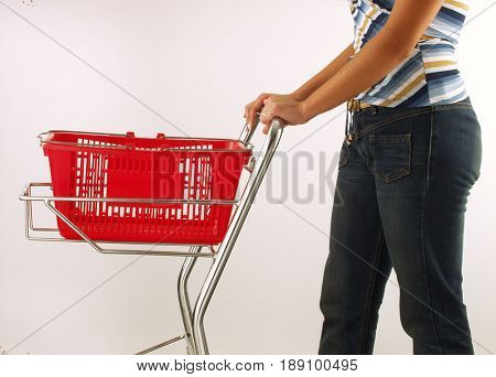 Woman with pharmaceutical supermarket shopping cart.