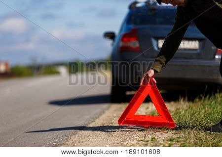 Photo of red emergency triangle on background of car during day