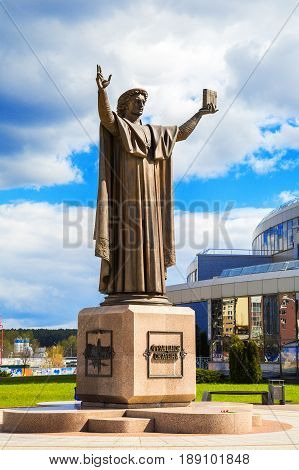 Belarus Minsk 11 May; 2017 a monument to Frantsuzsku Skorina against the backdrop of the National Library Independence Avenue architecture; Spring; Editorial