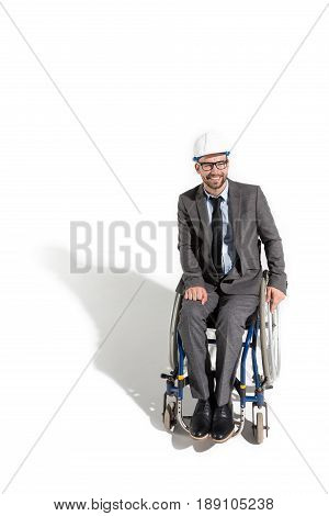 Smiling Disabled Architect Sitting In Wheelchair Isolated On White