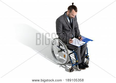 Young Physically Handicapped Businessman In Wheelchair Signing Contract