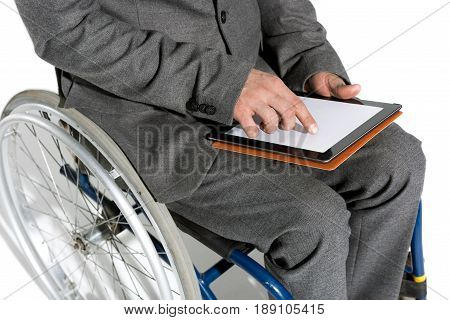 Physically Handicapped Businessman In Wheelchair Using Digital Tablet