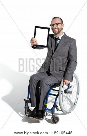 Young Physically Handicapped Businessman In Wheelchair With Digital Tablet
