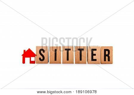 House Sitter - block letters with red home / house icon with white background