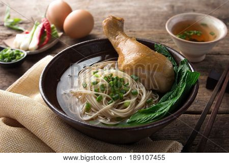 Asian noodles, bowl of noodles with vegetables and chicken
