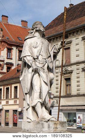 MARIBOR, SLOVENIA - APRIL 03: Saint Roch statue, Plague column at Main Square of the city of Maribor in Slovenia, Europe. Historical religious sculpture, April 03, 2016.