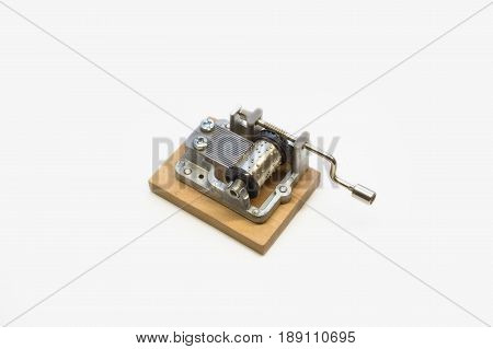 Closeup image of isolated small barrel organ on white background.