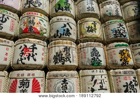 Tokyo Japan - May 5 2017: Sake Barrels stock up wall in Meiji Shrine.