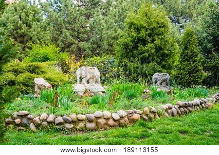 Beautiful landscape of a garden with statues of elephants