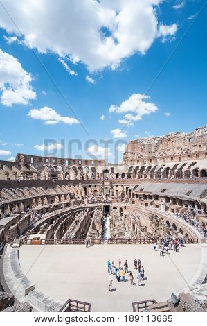 Rome Italy. 16 May 2017 : Tourists visiting Colosseum an oval amphitheatre in the center of the city of Rome. It is the famous landmark built of concrete and sand.