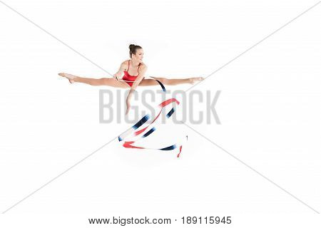 Young Caucasian Woman Rhythmic Gymnast Jumping With Colorful Rope