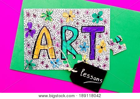 Art Jigsaw - hand drawn in colored pen on jigsaw puzzle with lessons written on chalkboard