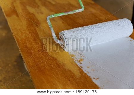 Painting The Wood With White Paint Roller