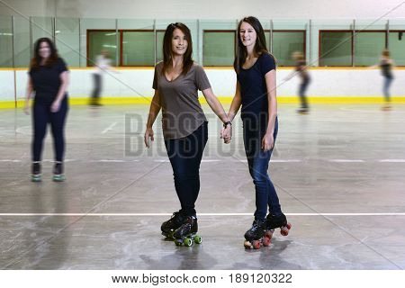 mother and daughter at roller skating rink focus on mom