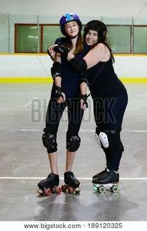 mother and daughter roller derby on quad skates hugging