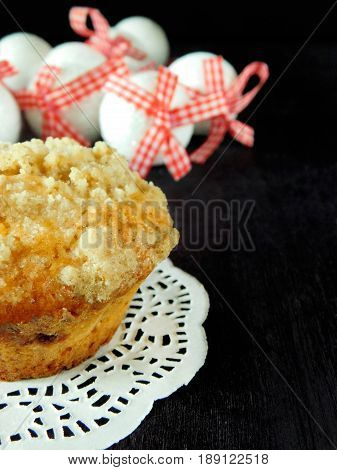 Muffin with streusel. Christmas decorations in the background. Empty place for a text