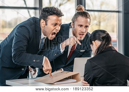 Young Emotional Businesspeople In Formalwear Arguing At Meeting In Office, Business Team Meeting