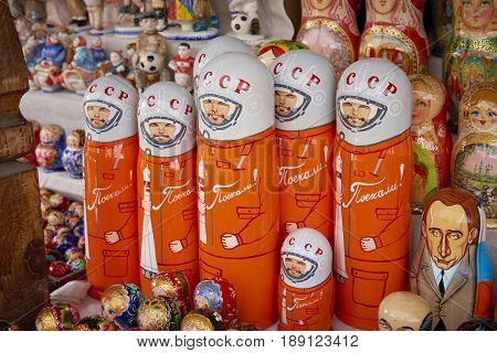 MOSCOW, MAY 26, 2017: Russian dolls matreshka at souvenir market shop. Traditional Russian handicraft hand made dolls with celebrities cartoon portraits first cosmonaut Uriy Gagarin, Vladimir Putin