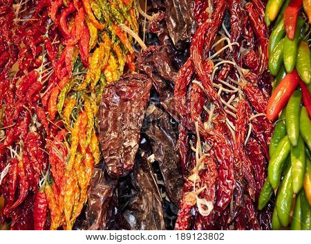 Lot of dried chili as a food background. Red dry Chili pepper background. Hot red chili pepper at market. Above pile of dried red chili pepper. Chili pepper background. Smoked red paprika. Dry paprika