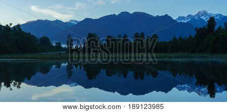 Panoramic image of beautiful reflection of Lake Matheson with mist and Mount Cook /Aoraki and Mount Tasman South Island of New Zealand