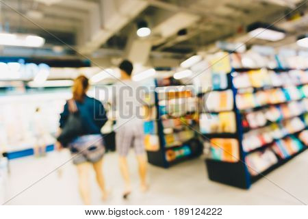 Blurred People Reding Book In Bookstore