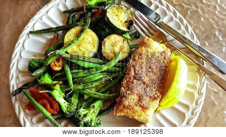 Plate of grilled grouper with roasted fresh vegetables