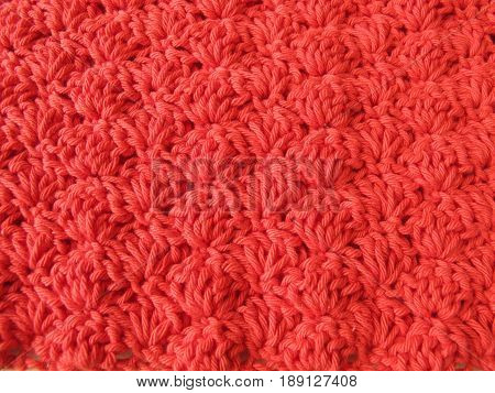 Background of crocheted shell pattern in red