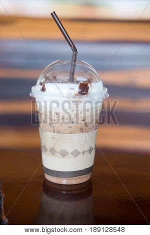 Iced mocha with milk micro foam in coffee shop