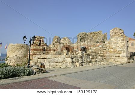 The fortification wall of Nessebar against the blue sky