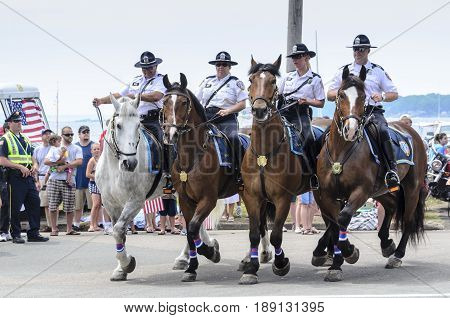 Bristol Rhode Island USA - July 4 2011: Members of the Providence Police Department Mounted Command at Independence Day parade in Bristol Rhode Island