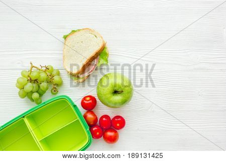 breakfast take away with lunchbox and fresh food on white wooden table background top view space for text