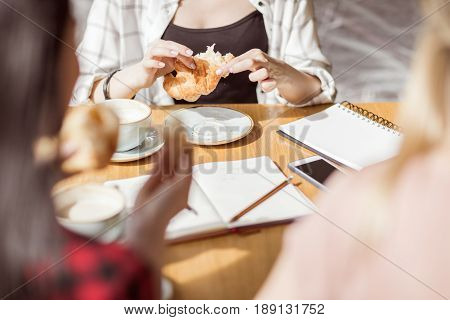 Young Girls Eating Croissants And Drinking Coffee At Cafe, Coffee Break