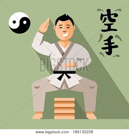 Athlete in kimono hit the wooden board. Isolated on a color Background