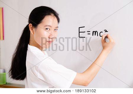 Chinese High School Girl Writing On Board