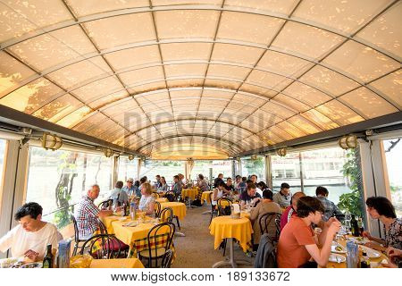 Isola dei Pescatori Italy May 22 2017 - a crowded touristic restaurant under a gazebo