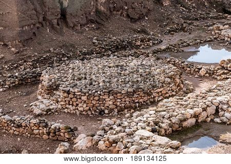 The remains of what is believed to be an ancient Canaanite altar near the ruins of the wall of a Canaanite temple at Tel Megiddo in Israel.