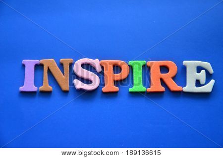 word inspire on a  abstract  blue background