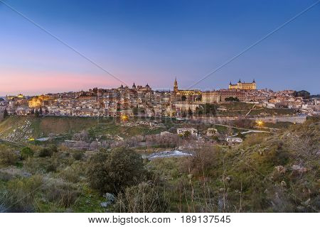 view of Toledo from across the Tagus river in evening Spain