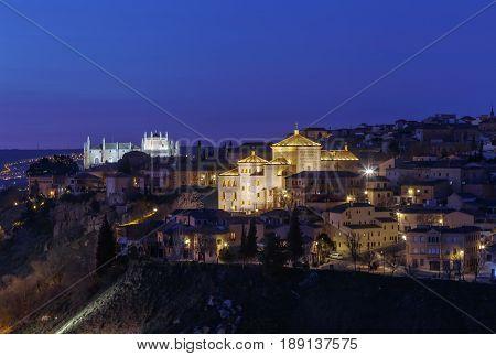 View of Toledo with Cortes of Castilla La Mancha in evening Spain