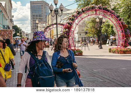 Russia, Moscow, Mary 23, 2017. Moscow streets, Tourists on Old Arbat