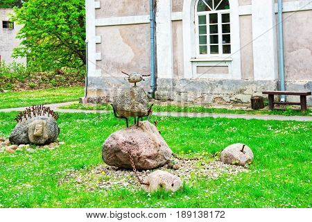 Vilnius, Lithuania - September 3, 2014: Rusty metal and stone figures at Traku Voke public park in Vilnius Lithuania.