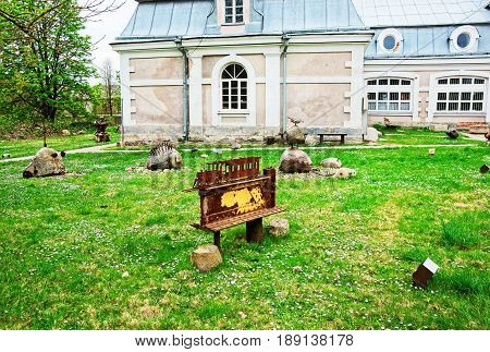Vilnius, Lithuania - September 3, 2014: Rusty metal figures at Traku Voke public park in Vilnius Lithuania.