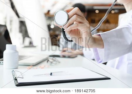 Close up of stethoscope in hand palm of a doctor cardiologist. Medicine health hospital equipment for health care treatment Healthcare and Medical concept
