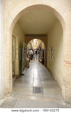 GRANADA, SPAIN - MAY 21, 2017: Entrance arch to the handicraft market in the city of Granada Andalusia Spain.