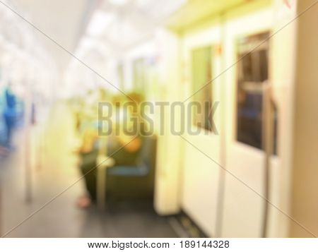 Blurred Image Of People Sitting On Mass Transit (sky Train Or Subway). Abstract Background City Peop